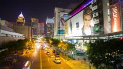 Taipei,Taiwan-October 16,2015: Busy Taipei Xinyi District street at night,4K Stock Footage