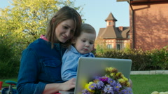 Stock Video Footage of Mother and Son Watching Cartoons in Laptop