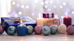 Christmas decoration with balls, gifts and candles, dolly shot - stock footage