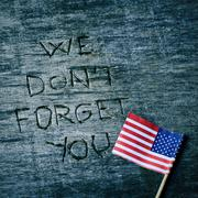 Text we do not forget you and the flag of the US Stock Photos