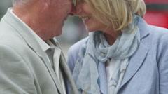 4K Close-up portrait, romantic mature couple share a kiss outdoors Stock Footage