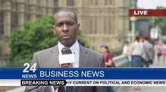 Stock Video Footage of 4K News reporter doing live piece to camera outside London Houses of Parliament.