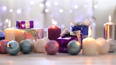 Christmas presents, balls and candles, dolly shot Stock Footage