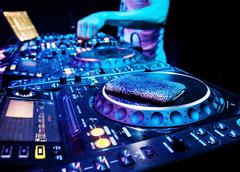Dj mixes the track in the nightclub at party Stock Photos