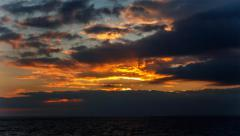 red-orange sunset over the sea of clouds. - stock footage