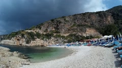 Thunderclouds above beach and few people there - stock footage