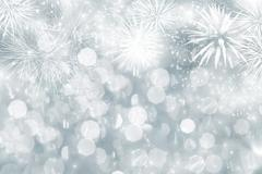 Abstract holiday background with fireworks and sparkling lights Stock Photos