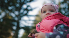 Close-up of a baby. In the hands holding a fir cones. Stock Footage