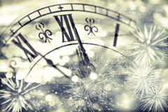 Old clock with fireworks and holiday lights Stock Photos