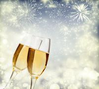 Holiday background with sparkling lights and champagne - stock photo