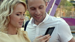 Lovers laughing funny and having fun with a smart phone Stock Footage