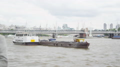 4K Portrait of romantic mature couple standing by side of London's River Thames Stock Footage