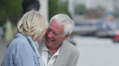 4K Portrait of romantic mature couple standing by side of London's River Thames - stock footage