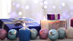 Christmas presents, balls and candles, Blurred bokeh background, dolly shot - stock footage