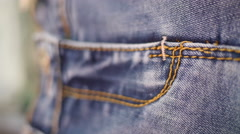 Jeans - denim fabric seam - suture threads overlock on clothes Stock Footage
