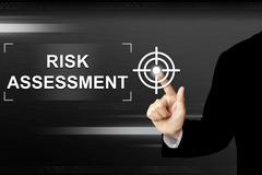Business hand pushing risk assessment button on touch screen Stock Illustration