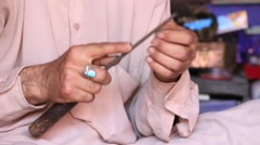 Indian jewelers at work in his workshop. Srinagar, Kashmir, India. Stock Footage