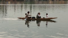 Local people in small boat for transportation in the lake of Srinagar, India Stock Footage