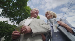 4K Happy romantic mature couple sightseeing in the city - stock footage