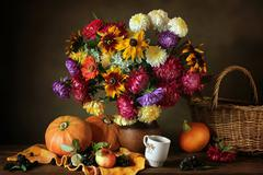 Still life with autumn flowers and pumpkins Stock Photos