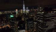 Stock Video Footage of Flying over the buildings and skyscrapers of New York City at night aerial