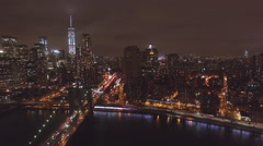 Flying over the buildings and skyscrapers of New York City at night aerial - stock footage