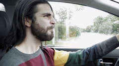 Hipster man listening rock music while driving car Stock Footage