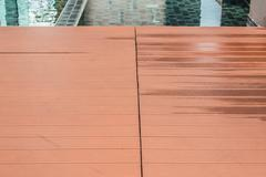 Slat floor at the swimming pool - stock photo