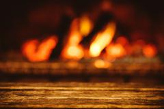 Warm cozy fireplace with real wood burning in it. Cozy evening i Stock Photos