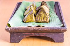 Stock Photo of Dessert wrapped in banana leaves
