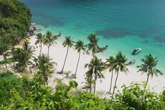 Tourists disembark at the beach, Koh Samui, Thailand. Stock Photos