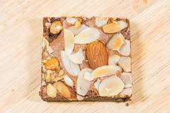 Homemade brownies sliced and  topping on  wooden background Stock Photos