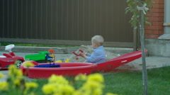 Little Boy on the Playground with Slingshot Stock Footage