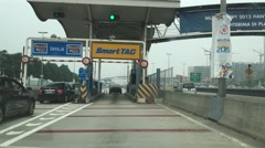 Driving through toll station smart tag automatic gate Stock Footage