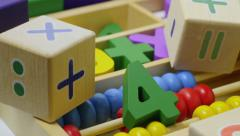 Stock Video Footage of Rotating multi-colored toy wooden numbers.
