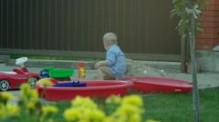 Boy Playing with Car in a Sandpit Stock Footage
