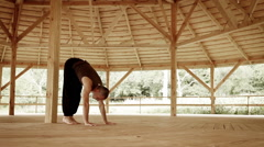 Professional yoga teacher shows Smooth handstand in high mountain trauning cente Stock Footage