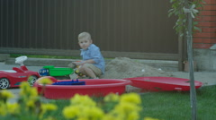 Boy Running to the Mother from the Playground Stock Footage