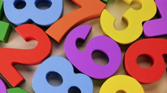 Colorful numbers on white background. Slowly turn. Stock Footage