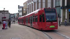 A London Tram Passes Trough An Intersection Stock Footage
