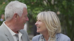 4K Portrait of happy mature couple in love, outdoors urban park area - stock footage