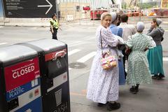 Mennonite girls on pavement in new york city near ground zero Stock Photos