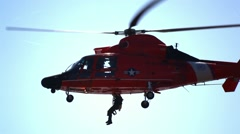 US Coast Guard Helicopter Performing Rescue Mission Stock Footage