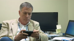 Businessman using his smartphone to send a text message 4k Stock Footage