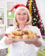 Happy granny  with cookies in Christmas night,Xmas concept Stock Photos