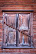 Vintage wooden window on old wall - stock photo