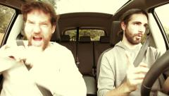 Two cool men driving car having fun color correction - stock footage