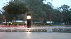 Rain On Sidewalk With Lighted Pillar From Dry Overhang - stock footage