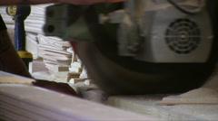 Worker Cutting Wood Board With Circular Saw Stock Footage