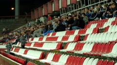View on the stadium stands, fans watching football game, soccer supporters, 4K. Arkistovideo
